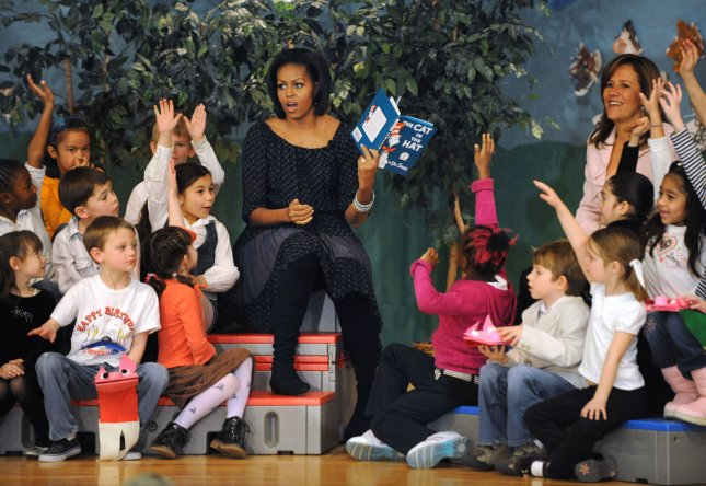 United States first lady Michelle Obama reads The Cat in the Hat with Mexican first lady Margarita Zavala (right) and schoolchildren at the Oyster-Adams Bilingual Elementary School in Washington, DC on March 3, 2011. Classes at the public school are taught in English and Spanish through 8th grade. UPI/Pat Benic
