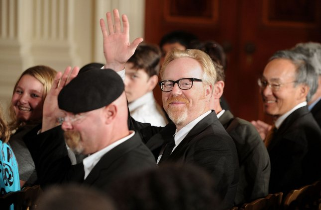 Science entertainment TV program Mythbusters hosts Adam Savage (C) and Jamie Hyneman (R) wave as US President Barack Obama makes remarks while hosting the White House Science Fair celebrating the winners of a broad range of science, technology, engineering and math (STEM) competitions in Washington on October 18, 2010. UPI/Olivier Douliery/Pool