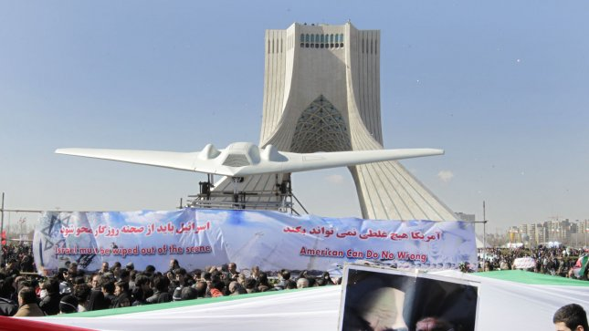 A replica of a U.S. drone is displayed in Freedom Square during the 33rd anniversary of the Islamic Revolution in Tehran, Iran on February 11, 2012. UPI/Maryam Rahmanian