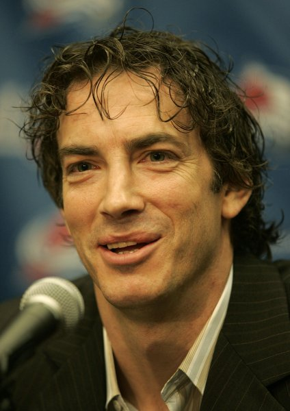 Colorado Avalanche captain Joe Sakic smiles after announcing his signing a new one-year deal to remain with the Colorado Avalanche during a press conference at the Pepsi Center in Denver April 9, 2007. Sakic joins NHL former great Gordie Howe as the only players to reach the 100 point mark at the age of 37 or older. Sakic finished the 2006-07 season with 36 goals and 64 assists. (UPI Photo/Gary C. Caskey)