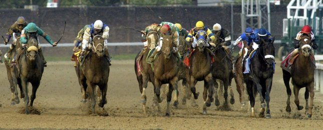 Giacomo (L, front), with jockey Mike Smith up, races to take the lead and win the 131st Kentucky Derby in Louisville, Ky., May 7, 2005. (UPI Photo/Frank Polich)