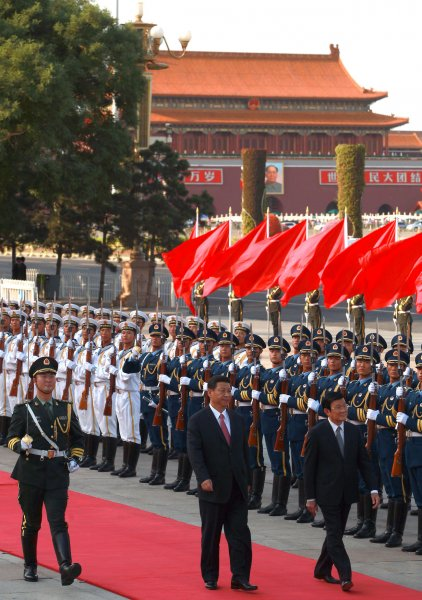Vietnam's President Troung Tan Sang (R) is escorted by Chinese President Xi Jinping during a welcoming ceremony at the Great Hall of the People in Beijing on June 19, 2013. President Troung, while on a mission to bolster economic cooperation and trade with China, hoped to ease the growing tension in the South China Sea where both countries claim to own the same territorial area. UPI/Stephen Shaver