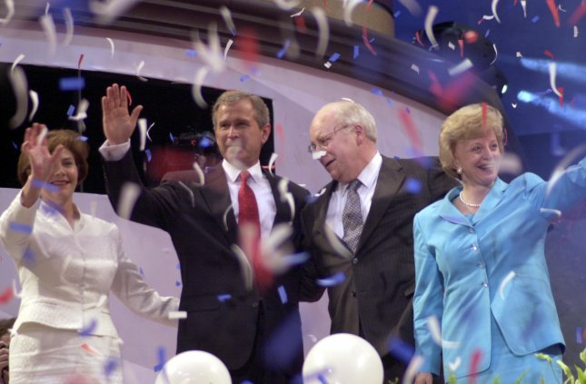 George W. Bush, his wife, Laura, and Dick Cheney and his wife, Lynne, acknowledge cheers from delegates at the conclusion of the Republican National Convention in Philadelphia, Aug. 3, 2000. cs/Ezio Petersen UPI