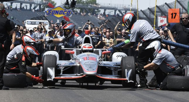 Will Power's crew works on one of the winning pit stops during a pre-race competition at the Indianapolis Motor Speedway in May. Photo by Larry Papke/UPI