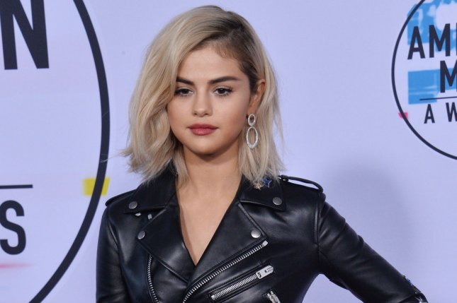 Selena Gomez won the award for Women of the Year Thursday at Billboard's Women in Music Awards. Mary J. Blige received the Icon Award. File Photo by Jim Ruymen/UPI