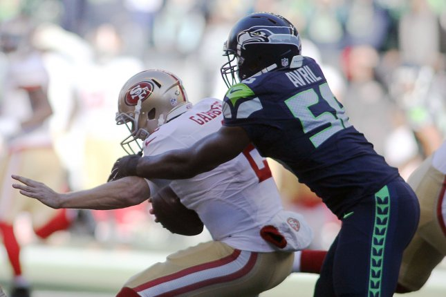Former Seattle Seahawks defensive end Cliff Avril (56) sacks San Francisco 49ers quarterback Blaine Gabbert (2) on November 22, 2015 at CenturyLink Field in Seattle, Washington. Photo by Jim Bryant/UPI
