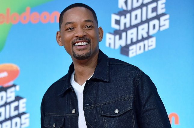 Will Smith said he hoped to pay homage to Robin Williams while bringing new flavor to Genie in Disney's live-action Aladdin. File Photo by Christine Chew/UPI