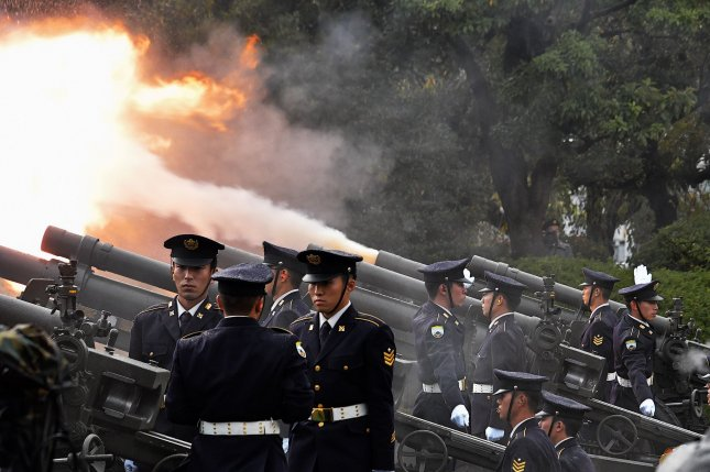 Members of the Japan Ground Self-Defense Forces fire a 21 gun salute Tuesday during a proclamation ceremony marking Emperor Naruhito's ascension to the throne at the Kitanomaru Park in Tokyo, Japan. Photo by Mori Keizo/UPI