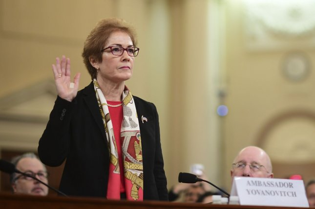Marie Yovanovitch, former U.S. ambassador to Ukraine, takes the oath before testifyng before the House Permanent Select Committee on Intelligence as part of the impeachment inquiry into President Donald Trump on Capitol Hill on Friday. Photo by Kevin Dietsch/UPI
