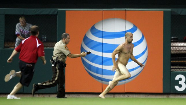Police prepare to take down a fan that ran onto the field between innings of a game between the Philadelphia Phillies and the St. Louis Cardinals at Busch Stadium in St. Louis on May 24, 2012. UPI/Bill Greenblatt