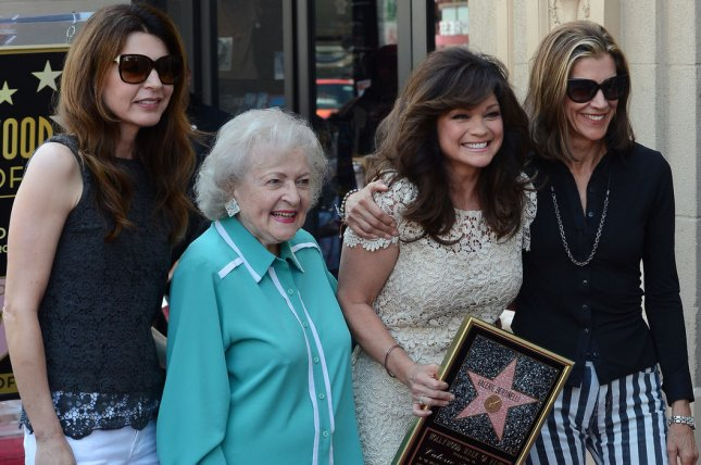 Valerie Bertinelli (3rd-L) holds a replica plaque during an unveiling ceremony honoring her with the 2,476th star on the Hollywood Walk of Fame in Los Angeles on August 22, 2012. Joining Bertinelli from left are Hot in Cleveland co-stars Jane Leeves, Betty White, (Bertinelli) and Wendie Malick. UPI/Jim Ruymen