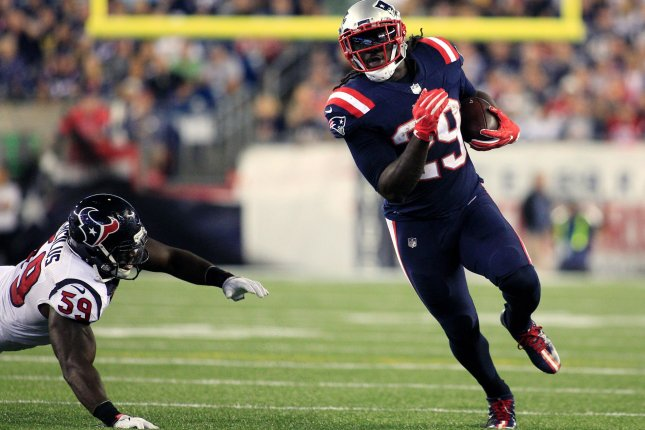 New England Patriots running back Legarrette Blount (29) dodges a tackle by Houston Texans linebacker Whitney Mercilus (59) on a carry in the third quarter at Gillette Stadium in Foxborough, Massachusetts on September 22, 2016. The Patriots defeated the Texans 27-0. Photo by Matthew Healey/ UPI