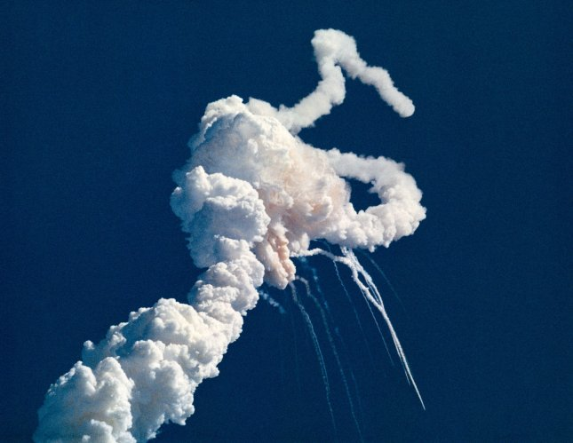 Main engine exhaust, solid rocket booster plume and an expanding ball of gas from the external tank is visible seconds after the launch of the Space Shuttle Challenger on January 28, 1986. At 11:39 a.m. EST, the Space Shuttle Challenger and her seven-member crew were lost when a ruptured O-ring in the right Solid Rocket Booster caused an explosion 73 seconds after launch. NASA/UPI