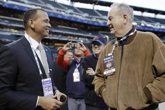 New York Yankees Alex Rodriguez and Bill O'Reilly stand on the field at Citi Field in New York in 2015. File Photo by John Angelillo/UPI