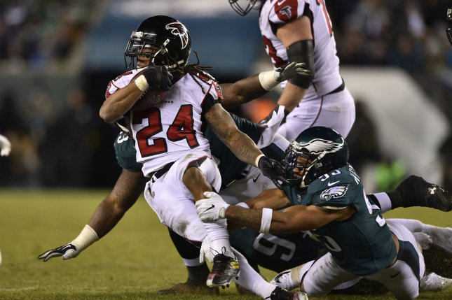 Atlanta Falcons running back Devonta Freeman (24) is tackled by Philadelphia Eagles linebacker Mychal Kendricks (95) during the third quarter of the NFC Divisional Round on January 13, 2018 at Lincoln Financial Field in Philadelphia. Photo by Derik Hamilton/UPI