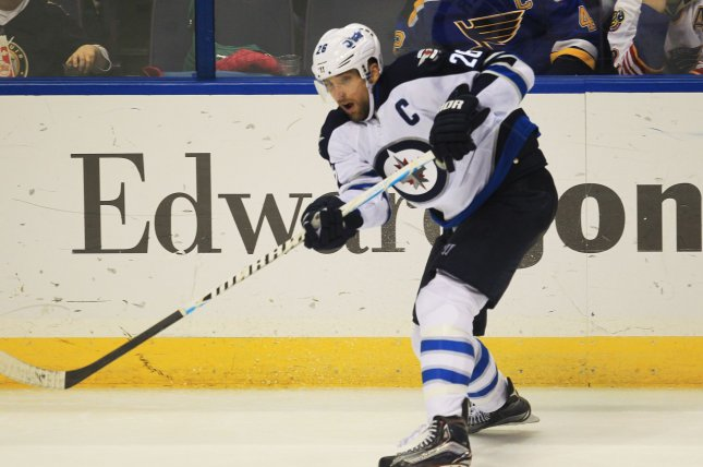 Winnipeg Jets captain Blake Wheeler passes the puck against the St. Louis Blues at the Scottrade Center in St. Louis. File photo by Bill Greenblatt/UPI