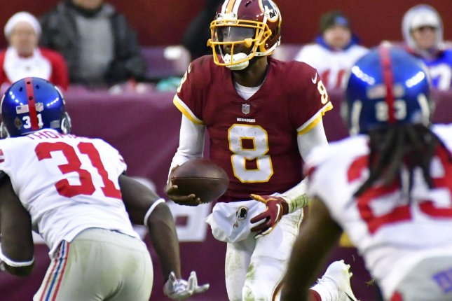 Washington Redskins quarterback Josh Johnson (8) runs a keeper play against the New York Giants during the second half of an NFL game on December 9 at FedEx Field in Landover, Md. Photo by David Tulis/UPI