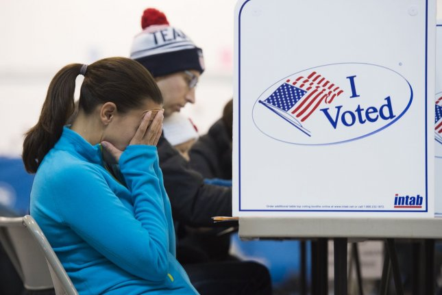 Voters fill out ballots at a polling center in Alexandria, Va., on election day, November 8, 2016. File Photo by Molly Riley/UPI