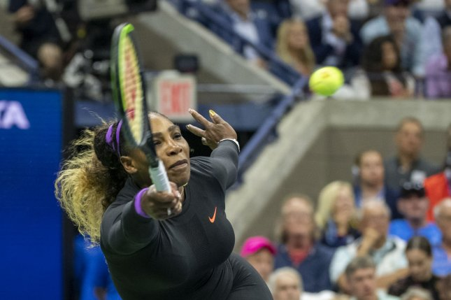 Serena Williams hits a forehand to Maria Sharapova in their first-round match Monday in Arthur Ashe Stadium at the 2019 U.S. Open Tennis Championships at the USTA Billie Jean King National Tennis Center. Photo by Corey Sipkin/UPI