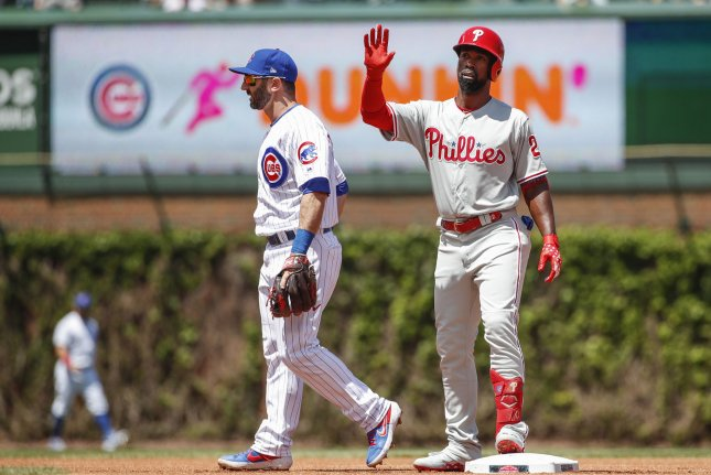 Philadelphia Phillies outfielder Andrew McCutchen (R) is recovering from a torn ACL that he sustained in June last season. File Photo by Kamil Krzaczynski/UPI