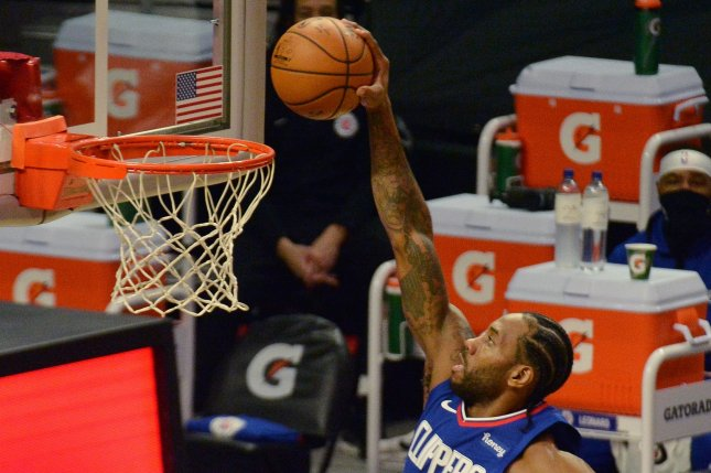 Los Angeles Clippers forward Kawhi Leonard dunks for 2 of his 32 points in a win over the Sacramento Kings on Wednesday night. Photo by Jim Ruymen/UPI