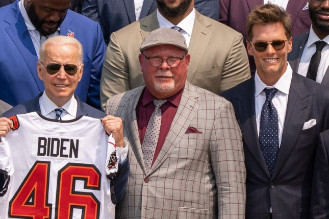 President Joe Biden (L-R), Tampa Bay Buccaneers coach Bruce Arians and quarterback Tom Brady pose for photos while at a White House visit Tuesday in Washington, D.C. Photo by Ken Cedeno/UPI