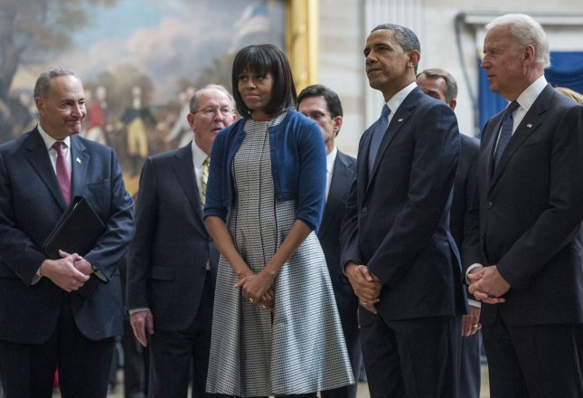 Vice President Joe Biden, President Barack Obama and First lady Michelle Obama pause to pay their respects at the Martin Luther King, Jr. statue in the Capitol rotunda as they leave the 2013 Inaugural Luncheon following President Obama's inauguration on Jan. 21. Also pictured in the back from left are Sen. Charles Schumer, D-N.Y., Sen. Lamar Alexander, R-Tenn., House Majority Leader Eric Cantor, R-Va., and Speaker of the House John Boehner, R-Ohio. UPI/Bill Clark/pool