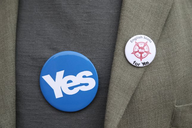 Yes Vote badges on a campaigners chest on the day Scottish residents decide the future political direction their country will take in Glasgow,Scotland on September 18, 2014. Ninety-seven percent of the population has registered to vote. The verdict will be announced tomorrow morning. UPI/Hugo Philpott