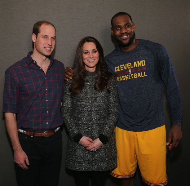Prince William, Duke of Cambridge and Catherine, Duchess of Cambridge, pose with LeBron James (R) backstage as they attend the Cleveland Cavaliers vs. Brooklyn Nets game at Barclays Center on December 8, 2014 in the Brooklyn borough of New York City. UPI/Neilson Barnard/Pool