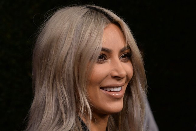 Kim Kardashian faced backlash after crediting daughter North West with a photo of herself taking off her bra. File Photo by Jim Ruymen/UPI