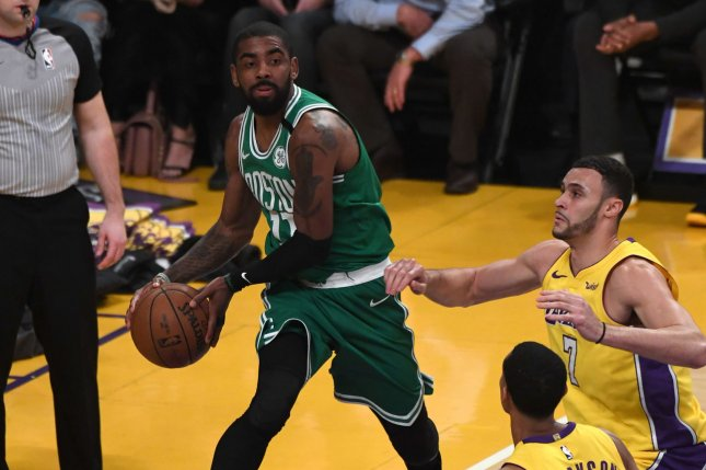 Boston Celtics point guard Kyrie Irving passes the ball against the Los Angeles Lakers on January 23, 2018 at Staples Center in Los Angeles. File photo by Jon SooHoo/UPI