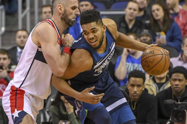 Minnesota Timberwolves center Karl-Anthony Towns (32) remains in the league's concussion protocol after being involved in a car accident. File Photo by Mark Goldman/UPI