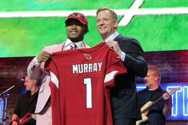 Oklahoma's Kyler Murray poses with NFL Commissioner Roger Goodell during last month's NFL Draft. Murray said he had sore feet after his first NFL practice. File Photo by John Sommers II/UPI