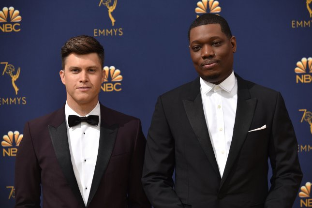 Comedians Colin Jost and Michael Che (R) attend the 70th annual Primetime Emmy Awards in Los Angeles in 2018. Che's HBO Max show has been renewed for a second season. File Photo by Christine Chew/UPI