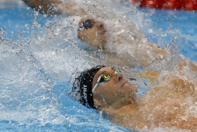 Team USA's Ryan Murphy (bottom) swims against the Russian Olympic Committee's Evgeny Rylov (top) in the men's 200-meter backstroke final at the 2020 Summer Games on Friday at the Tokyo Aquatics Center in Tokyo. Photo by Tasos Katopodis/UPI