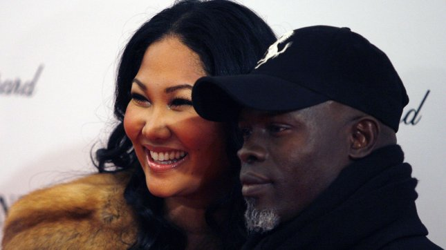 Designer Kimora Lee Simmons (L) and actor Djimon Hounsou arrive on the red carpet for the Premiere of Nine at the Ziegfeld Theater in New York City on December 15, 2009. UPI/John Angelillo