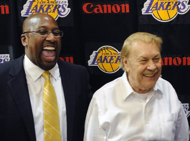 Mike Brown (L) and Los Angeles Lakers' owner Jerry Buss (R) share a laugh following a news conference to announce Brown as the team's new head coach in El Segundo, Calif., May 31, 2011. UPI/Jim Ruymen