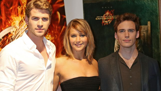 Liam Hemsworth (L), Jennifer Lawrence (C) and Sam Claflin arrive at a photo call for the film The Hunger Games: Catching Fire during the 66th annual Cannes International Film Festival in Cannes, France on May 18, 2013. UPI/David Silpa
