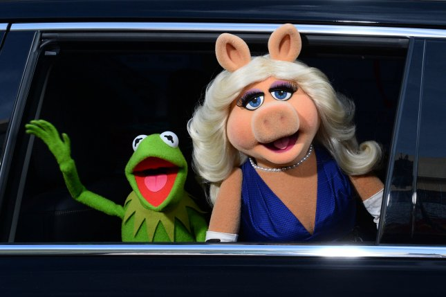 Kermit the Frog and Miss Piggy at the Los Angeles premiere of 'Muppets Most Wanted' on March 11, 2014. The fictional couple announced their split Tuesday. File photo by Jim Ruymen/UPI