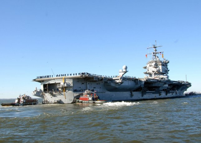 The aircraft carrier USS Enterprise departs from Naval Station Norfolk, January 13, 2011. The U.S. Navy this week awarded General Atomics a $195 million contract for the manufacture, assembly, inspection and testing for advanced arresting gear on the vessel. U.S. Navy photo by Eric Garst