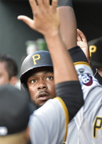 Josh Bell of the Pittsburgh Pirates is greeted in the dugout after scoring a run. Photo by David Tulis/UPI