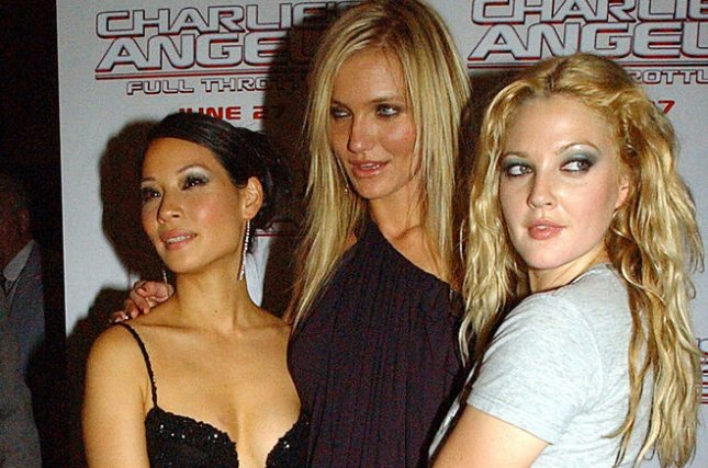 Actresses Lucy Liu, Cameron Diaz and Drew Barrymore attend the June 25, 2003 New York premiere of their film Charlie's Angels Full Throttle. File Photo by Ezio Petersen/UPI
