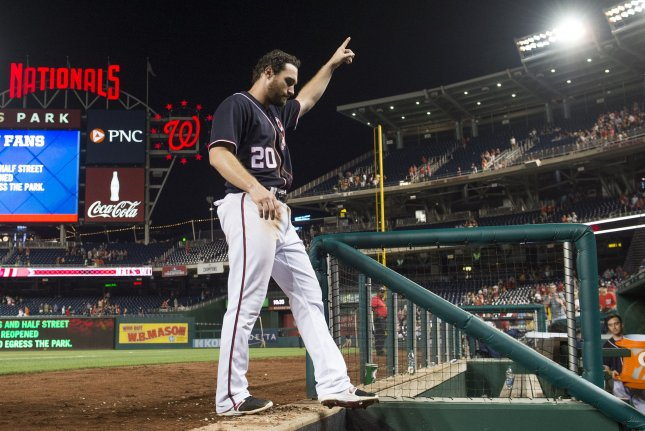 Washington Nationals second baseman Daniel Murphy (20) walks into the dugout after hitting a home run. File photo by Kevin Dietsch/UPI
