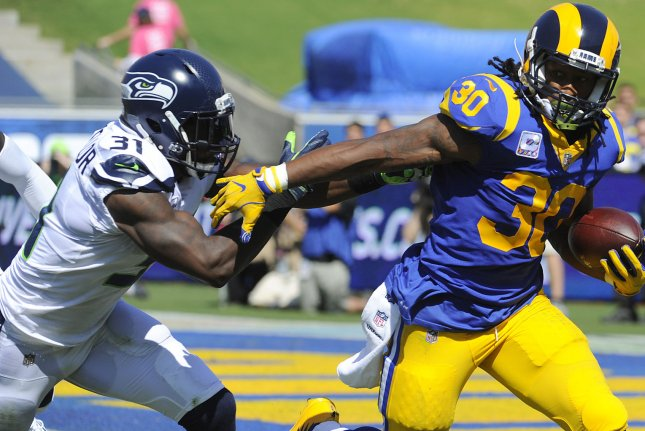 Los Angeles Rams running back Todd Gurley II gets away from Seattle Seahawks safety Kam Chancellor in the first half on October 8 at the Memorial Coliseum in Los Angeles, Calif. Photo by Lori Shepler/UPI
