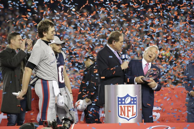 ... Kraft (R) holds the Lamar Hunt Trophy after quarterback Tom Brady (L)  led a fourth quarter comeback f1caf9748