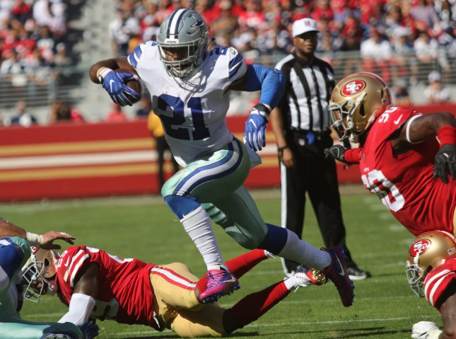 Dallas Cowboys running back Ezekiel Elliott leaps over a defender during a game against the San Francisco 49ers during their game in October. Photo by Bruce Gordon/UPI