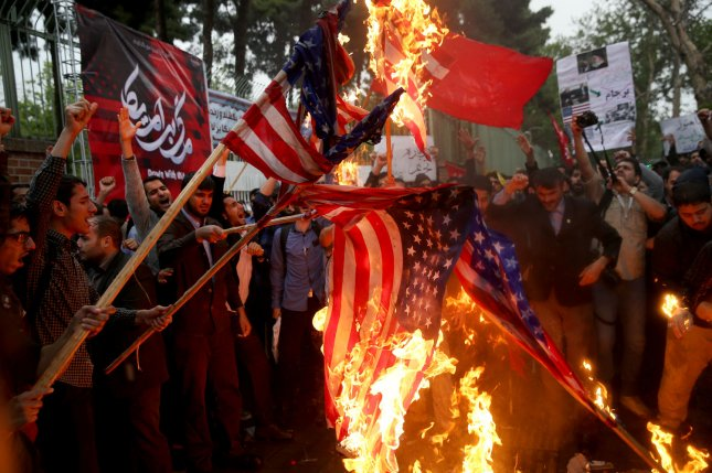 Iranians burn U.S. flags during a protest Wednesday in front of the former U.S. embassy in Tehran, Iran. Photo by Maryam Rahmanian/UPI
