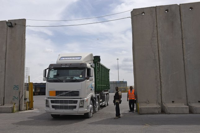 A truck transports cargo from Israel to Gaza at the Kerem Shalom crossing in the southern Gaza Strip. On Monday, Israeli officials ordered the crossing closed. File Photo by Debbie Hill/UPI