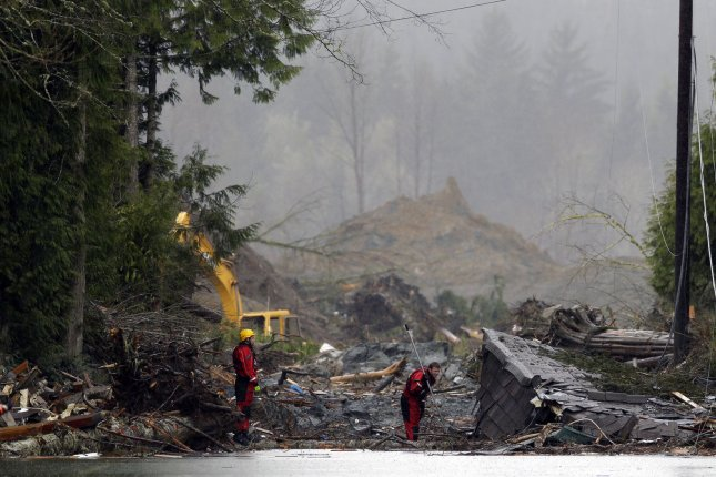 Search and rescue personnel work in the debris field in Oso, Washington. With over 30 dead and people still missing, President Obama announces plans to visit Oso in late April to assess damage and show the federal government's support. UPI/Ted Warren/Pool