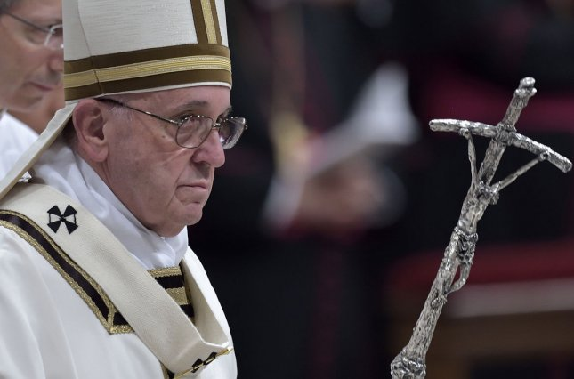 Pope Francis celebrates Christmas Eve Mass at St. Peter's Basilica in Vatican City on December 24, 2015. In his homily the 79-year-old Argentine Pope, who is the leader of 1.2 billion Roman Catholics, contrasted the birth of Jesus to societies that are intoxicated by consumerism and hedonism. Photo by Stefano Spaziani/UPI